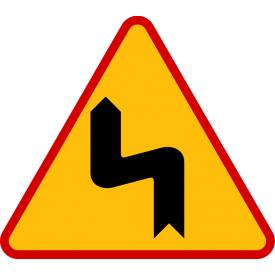 A-4 Niebezpieczne zakręty - pierwszy w lewo - znak ostrzegawczy
